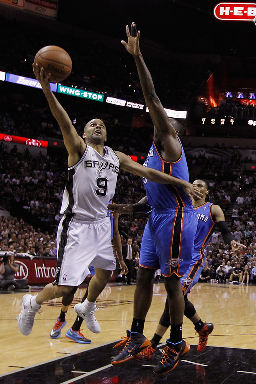 . Tony Parker #9 of the San Antonio Spurs drives to the basket against Kendrick Perkins #5 of the Oklahoma City Thunder in the first half during Game Five of the Western Conference Finals of the 2014 NBA Playoffs at AT&T Center on May 29, 2014 in San Antonio, Texas.   (Photo by Chris Covatta/Getty Images)
