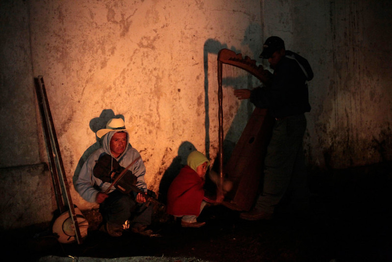 ". Musicians perform around a sacred fire during the pre-Hispanic mass of ""The welcome of the Grandfather Sun and of the Sacred New Fire to the Humanity\"", to receive the 13th Baktun, in the morning, outside the Chi Ixim church in Tactic, Alta Verapaz region, Guatemala, December 21, 2012. This week, at sunrise on Friday, December 21, an era closes in the Maya Long Count calendar, an event that has been likened by different groups to the end of days, the start of a new, more spiritual age or a good reason to hang out at old Maya temples across Mexico and Central America. The Chi Ixim church is a sacred Mayan site. REUTERS/Jorge Dan Lopez"