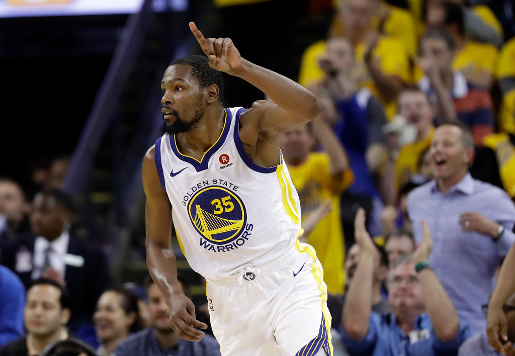 . Golden State Warriors forward Kevin Durant reacts after scoring against the Cleveland Cavaliers during the second half of Game 1 of basketball\'s NBA Finals in Oakland, Calif., Thursday, May 31, 2018. (AP Photo/Marcio Jose Sanchez)