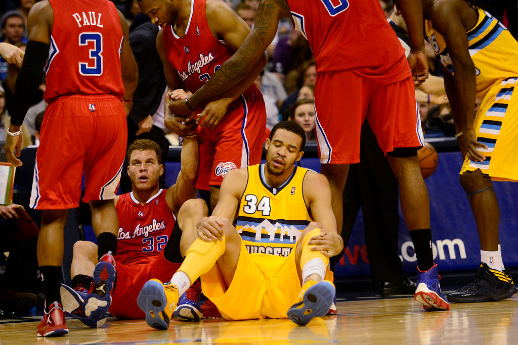 . Denver Nuggets center JaVale McGee (34) sits on the ground after fouling Los Angeles Clippers power forward Blake Griffin (32) during the first half at the Pepsi Center on Tuesday, January 1, 2013. AAron Ontiveroz, The Denver Post