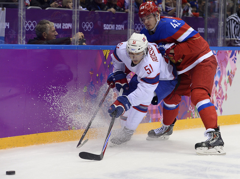 . Russia\'s Valeri Nichushkin (R) vies with Norway\'s Mats Rosseli Olsen during the Men\'s Ice Hockey play-offs qualification match Russia vs Norway at the Bolshoy Ice Dome during the Sochi Winter Olympics on February 18, 2014.  (JONATHAN NACKSTRAND/AFP/Getty Images)