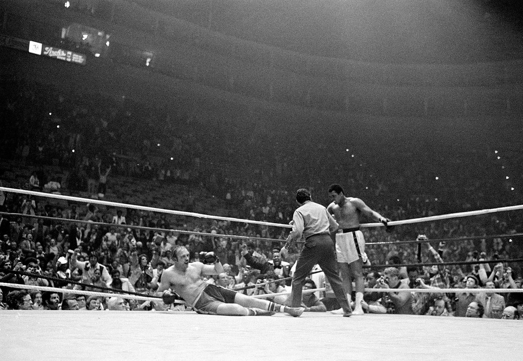 . Challenger Chuck Wepner lies on the canvas after he is knocked out by his opponent, defending heavyweight champion Muhammad Ali, in the 15th round of their title bout at the Richfield Coliseum, in Cleveland, Ohio, on March 24, 1975. The referee is Tony Perez. (AP Photo)