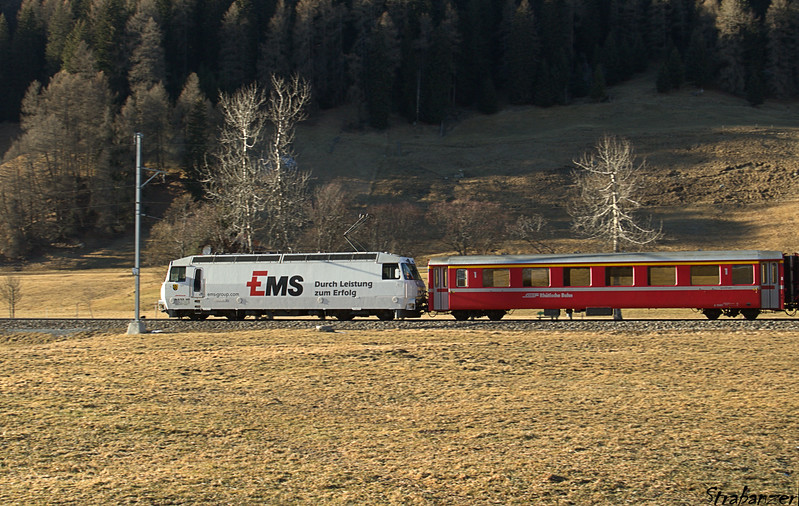 """This work is licensed under a Creative Commons Attribution- NonCommercial 4.0 International License.  Islen, Graubunden, Switzerland    12/27/2016 Ge 4/4 III Loco #643 """"Vals"""" bearing logo of EMS Chemie Holding AG"""