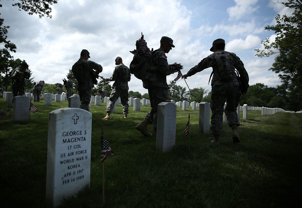 """. Members of the Fife and Drum Corps of the 3rd U.S. Infantry Regiment, \""""The Old Guard,\"""" participate in a \""""Flags-In\"""" ceremony May 23, 2013 at Arlington National Cemetery in Arlington, Virginia.   (Photo by Alex Wong/Getty Images)"""