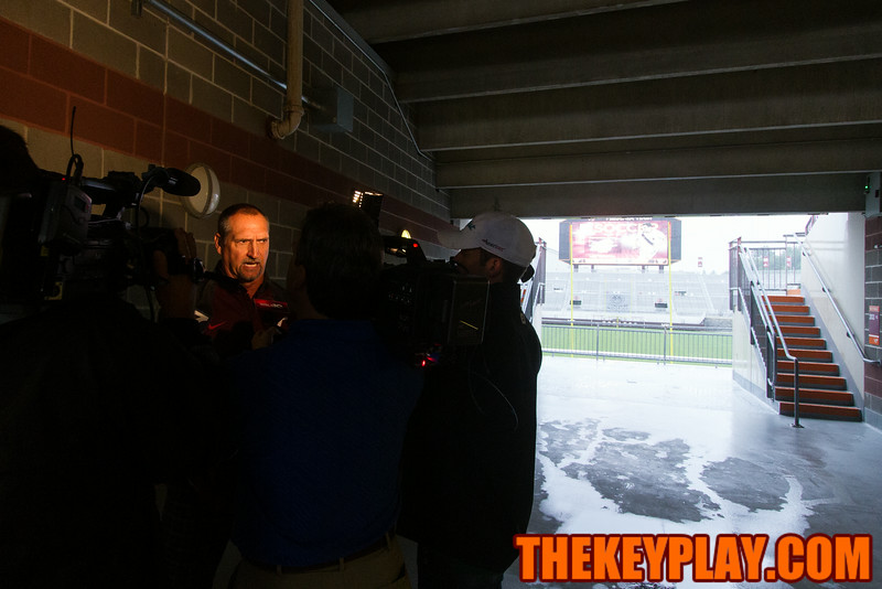 Bud Foster gets interviewed under the South Endzone stands during Media Day.