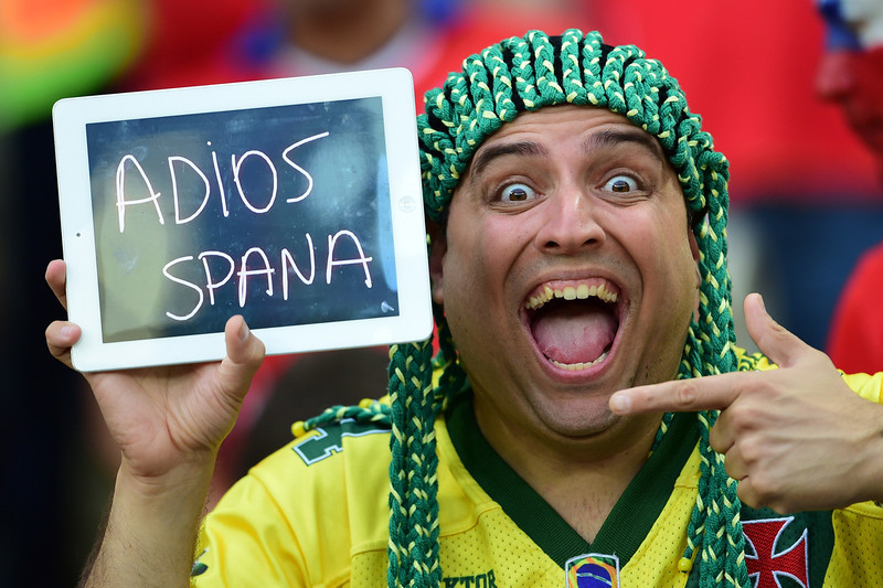 """. A Chile fans holds a sign reading in Spanish \""""Goodbye Spain\"""" after Spain lost their Group B football match against Chile in the Maracana Stadium in Rio de Janeiro during the 2014 FIFA World Cup on June 18, 2014.  (MARTIN BERNETTI/AFP/Getty Images)"""