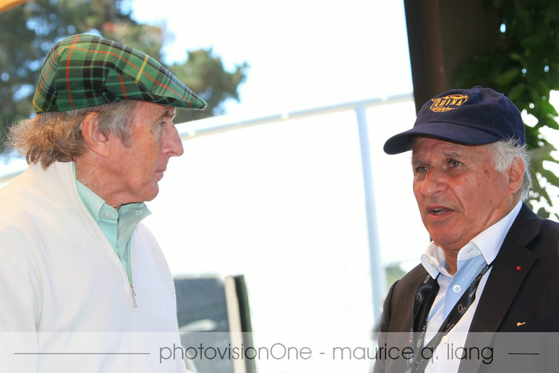 Race driver Jackie Stewart (left) chats with Quail owner Sir Michael Kadoorie.
