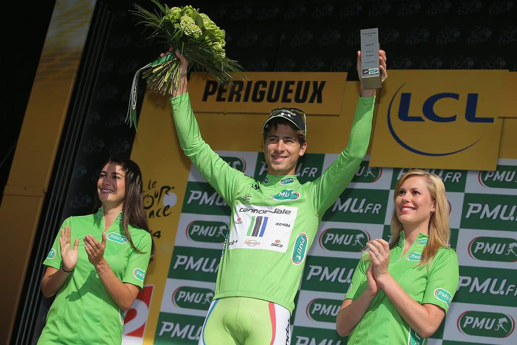 . Peter Sagan of Slovakia and Cannondale takes the podium after defending the points leader\'s green jersey in the individual time trial during the twentieth stage of the 2014 Tour de France, a 54km individual time trial stage between Bergerac and Perigueux, on July 26, 2014 in Perigueux, France.  (Photo by Doug Pensinger/Getty Images)