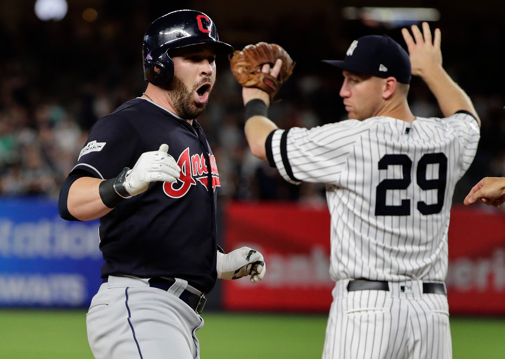 . Cleveland Indians\' Jason Kipnis, left, reacts as New York Yankees third baseman Todd Frazier (29) looks on after tripling to right field during the fourth inning in Game 3 of baseball\'s American League Division Series, Sunday, Oct. 8, 2017, in New York. (AP Photo/Frank Franklin II)