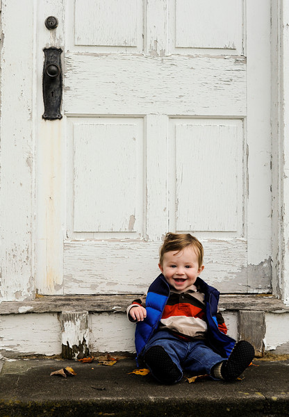 Jack in front of an old, whitewashed building in Center Shaftsbury Cemetery