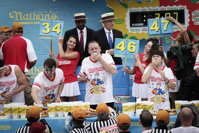 . Joey Chestnut ( C)  wins the 98th annual 2014 Nathan\'s Famous Hot Dog Eating Contest at Coney Island on July 4, 2014 in the Brooklyn borough of New York City.  Chesnut won his eighth straight Nathan\'s Hot Dog Eating Contest with 61 hot dogs. (Photo by Kena Betancur/Getty Images)