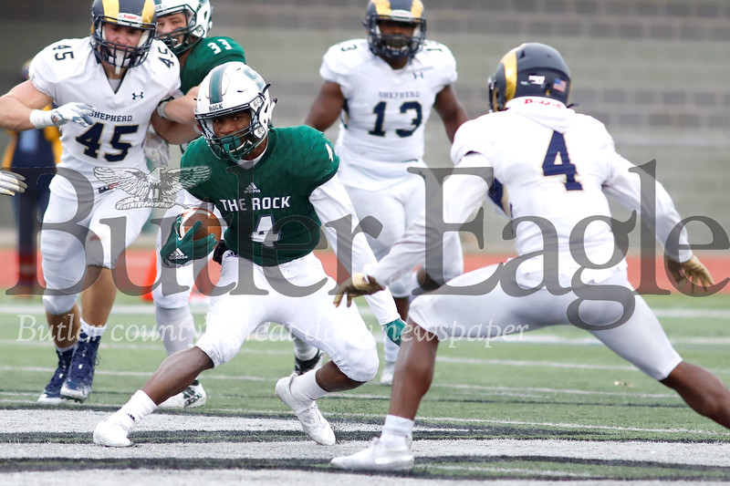 Slippery Rock running back Charles Snorweah (4) jukes past against Shepherd University safety Ponce Deleon (4) in Saturday's 51-30 home playoff win. Seb Foltz/Butler Eagle