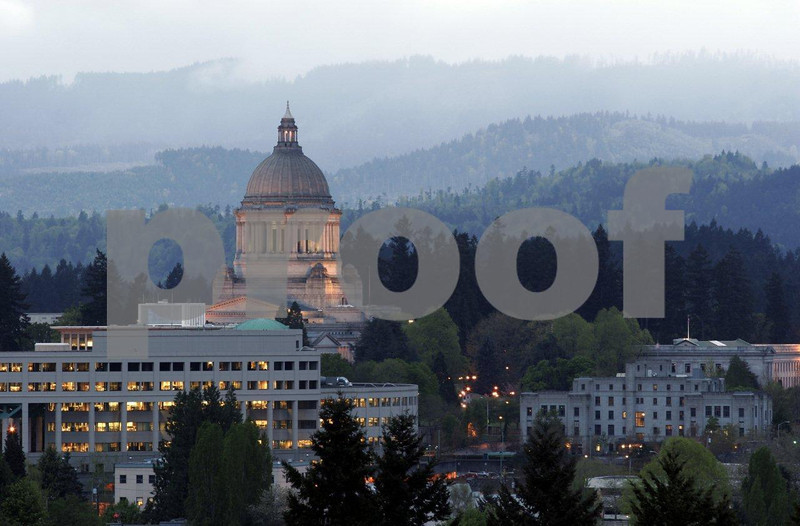The Washington State capitol campus in Olympia with the Black Hills in the background as seen after sunset.