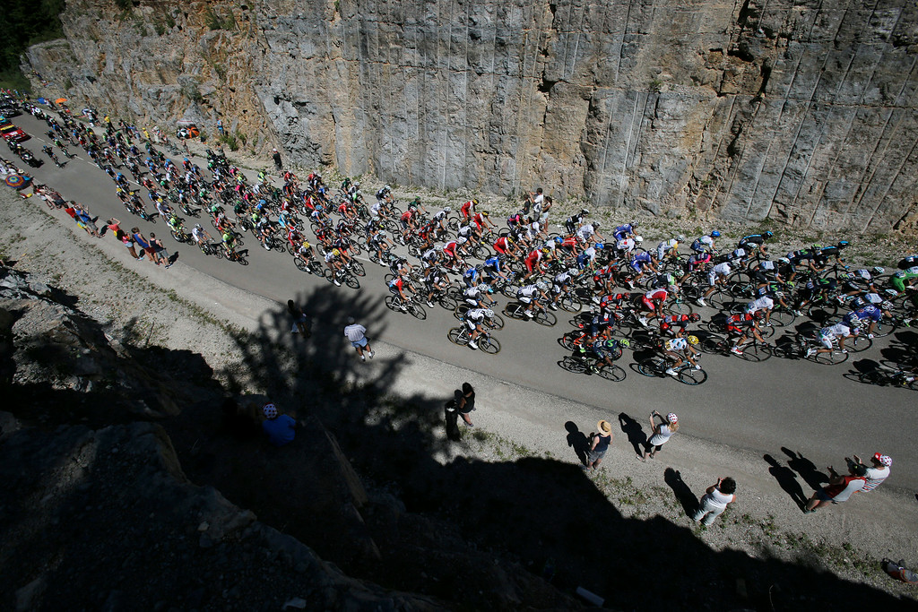 . The pack passes during the eleventh stage of the Tour de France cycling race over 187.5 kilometers (116.5 miles) with start in Besancon and finish in Oyonnax, France, Wednesday, July 16, 2014. (AP Photo/Christophe Ena)