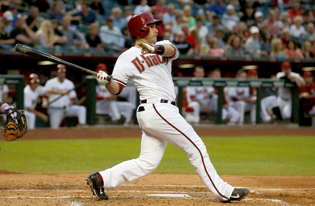 . Arizona Diamondbacks\' Miguel Montero connects for a double against the Colorado Rockies during the second inning of a baseball game on Tuesday, April 29, 2014, in Phoenix. (AP Photo/Ross D. Franklin)