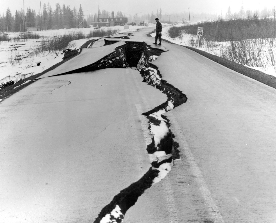 . Alaska Earthquake March 27, 1964. Fissures in Seward Highway near The Alaska Railroad station at Portage, at the head of Turnagain Arm. Many bridges were also damaged. At some places, tectonic subsidence and consolidation of alluvial materials dropped both highway and railroad below high-tide levels. Photo by U.S. Army. U.S. Geological Survey
