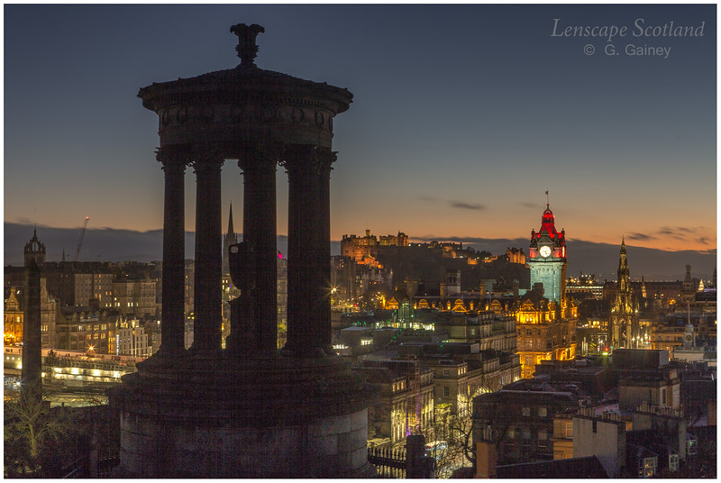 Dugald Stewart monument and central Edinburgh at dusk from Calton Hill