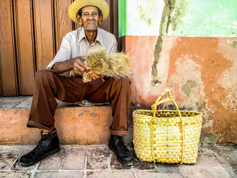 Man on street, selling brooms, Trinidad, Cuba