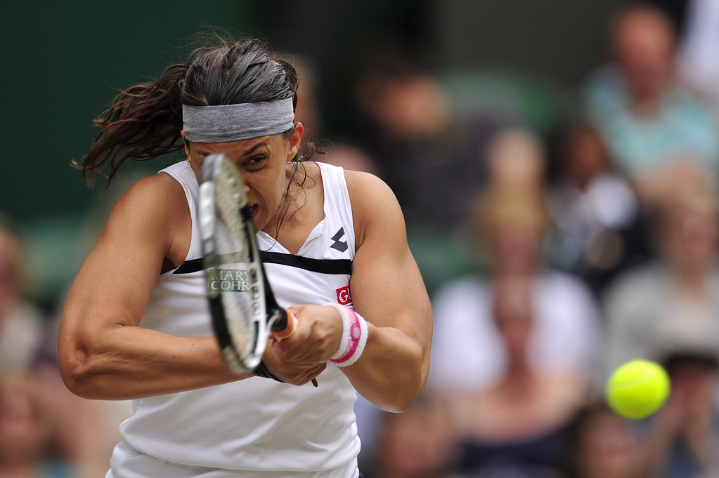 . France\'s Marion Bartoli returns against Belgium\'s Kirsten Flipkens during their women\'s singles semi-final match on day ten of the 2013 Wimbledon Championships tennis tournament at the All England Club in Wimbledon, southwest London, on July 4, 2013. GLYN KIRK/AFP/Getty Images