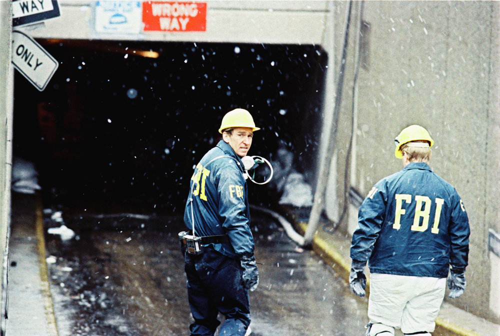 Description of . FBI investigators make their way to the underground parking garage at the World Trade Center in New York, March 5, 1993, as they continue their investigation into last week's blast at the twin towers.  Authorities have made an arrest in connection with the case.  (AP Photo/Paul Hurschmann)
