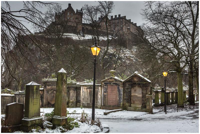 Saint Cuthbert's graveyard and Edinburgh Castle in winter