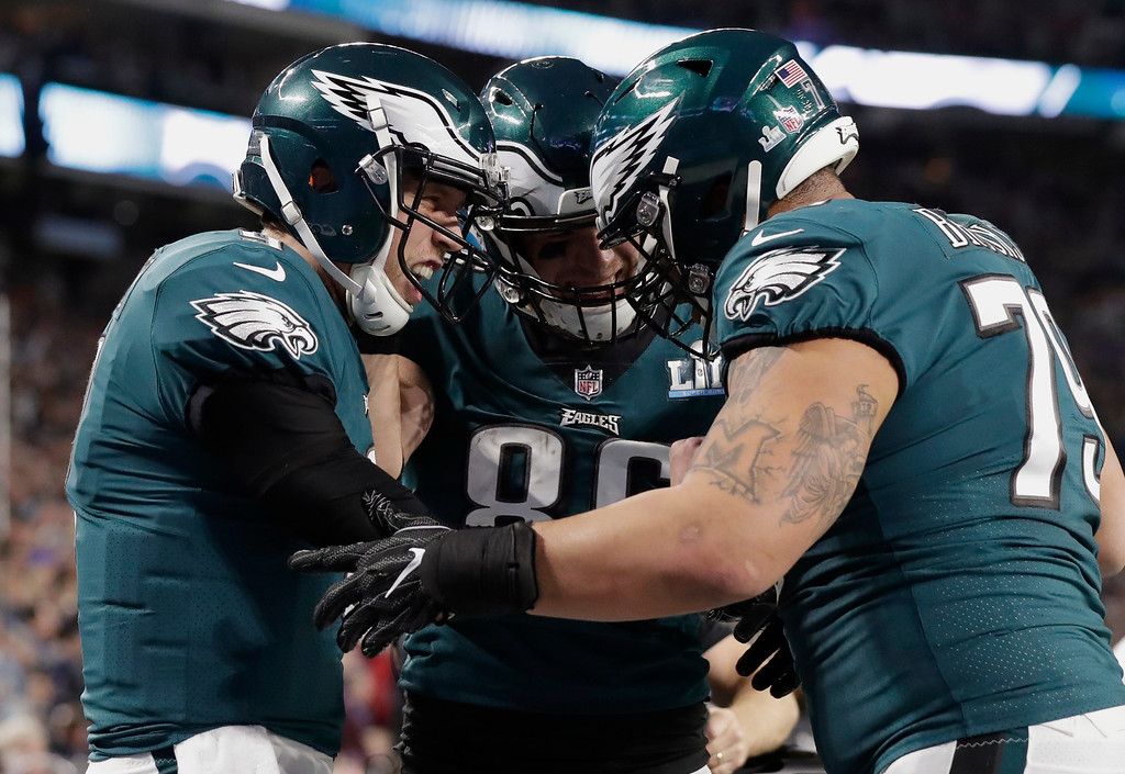 . Philadelphia Eagles quarterback Nick Foles, left, celebrate a touchdown with tight end Zach Ertz (86) and offensive guard Brandon Brooks (79), during the first half of the NFL Super Bowl 52 football game against the New England Patriots, Sunday, Feb. 4, 2018, in Minneapolis. (AP Photo/Tony Gutierrez)