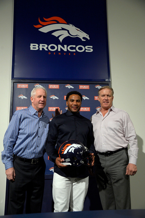 . Denver Broncos head coach John Fox, T.J. Ward and John Elway, General Manager and Executive Vice President of Football Operations pose for a photo after a press conference March 12, 2014 at Dove Valley. The Broncos have agreed to terms with former Cleveland Browns strong safety T.J. Ward, who is coming off a Pro Bowl season. Ward will sign a four-year contract for $23 million � with $14 million guaranteed. (Photo by John Leyba/The Denver Post)