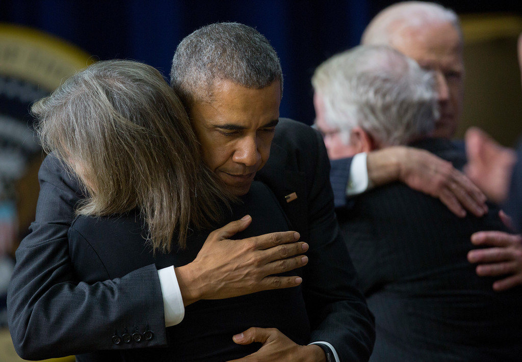 . President Barack Obama hugs Kate Grubb, and Vice President Joe Biden hugs her husband David Grubb before the president signed the 21st Century Cures Act, Tuesday, Dec. 13, 2016, in the South Court Auditorium in the Eisenhower Executive Office Building on the White House complex in Washington. The Grubb family, from Charleston W.Va., lost their daughter Jessie Grubb in the spring of 2016 after a long battle with substance abuse. Grubb\'s story gained recognition after Obama visited Charleston in October 2015, focusing on the drug epidemic.(AP Photo/Pablo Martinez Monsivais)