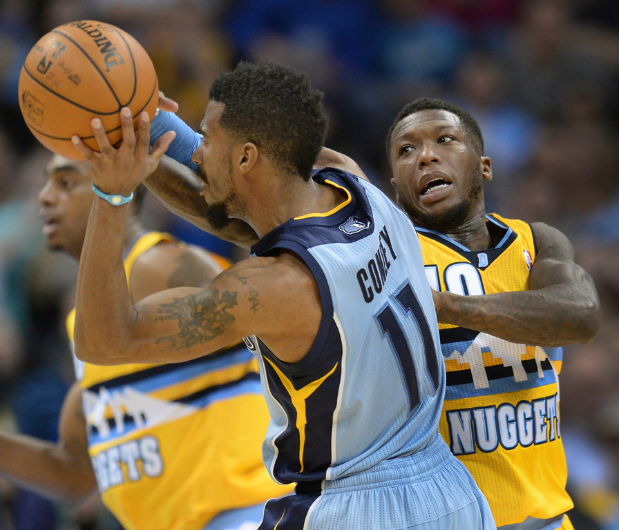 . DENVER, CO. - JANUARY 03:  Memphis guard Mike Conley (11) looked for a way past Denver guard Nate Robinson (10) in the second half. The Denver Nuggets broke an eight-game losing streak with a 111-108 win over the Memphis Grizzlies at the Pepsi Center Friday night, January 3, 2014. Photo By Karl Gehring/The Denver Post