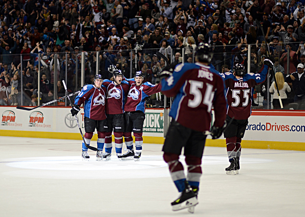 . DENVER, CO. - APRIL 13 : From left, Colorado Avalanche Tyson Barrie (41), Jan Hejda (8), Paul Ststny (26), David Jones (54) and Cody McLeod (55) celebrate the winning goal of Hejda in the 3rd period of the game against Vancouver Canucks at Pepsi Center. Denver, Colorado. April 13, 2013. Colorado won 4-3. (Photo By Hyoung Chang/The Denver Post)