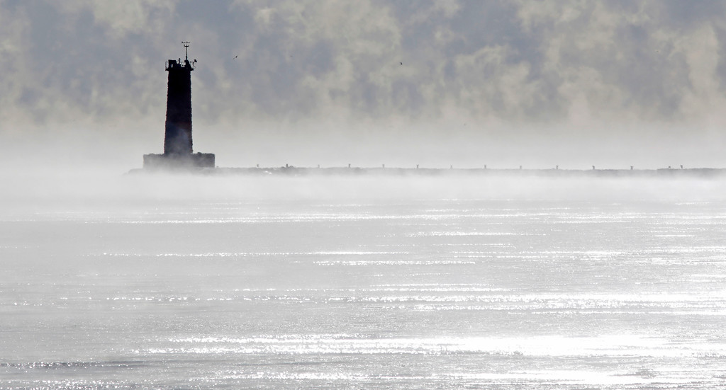 . The Sheboygan lighthouse looks lonely among the steam rising from Lake Michigan due to the cold morning temperatures, Tuesday Dec. 26, 2017, at Sheboygan, Wis. (Gary C. Klein/The Post-Crescent via AP)