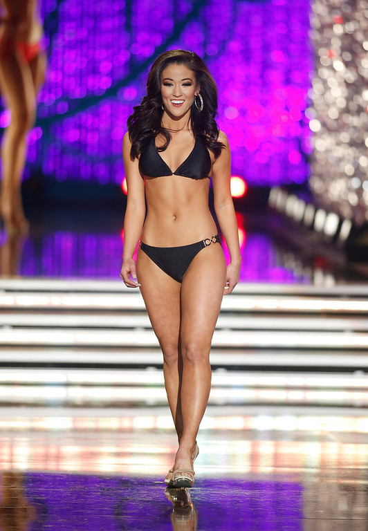 . Miss Oklahoma Alicia Clifton competes in the swimsuit portion of the Miss America 2013 pageant on Saturday, Jan. 12, 2013, in Las Vegas. (AP Photo/Isaac Brekken)