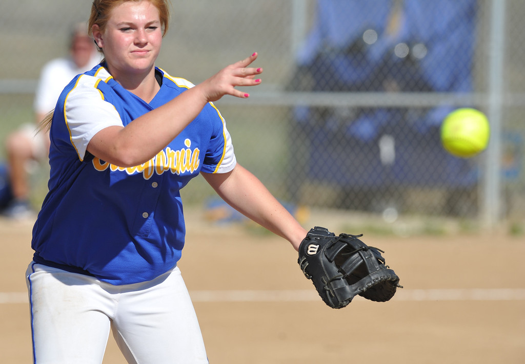 . California first baseman Heather Terranova (#15) throws to first base as they play Bell Gardens in their non-league game at California High School in Whittier on Thursday March 14, 2013. California beat Bell Gardens 11-0 in five innings. (SGVN/Staff Photo by Keith Durflinger)