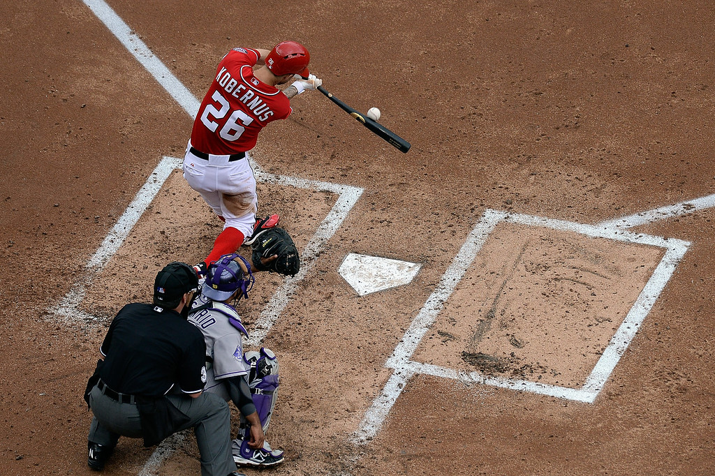 . Jeff Kobernus #26 of the Washington Nationals hits a fly ball out to center in the third inning during a game against the Colorado Rockies at Nationals Park on June 23, 2013 in Washington, DC.  (Photo by Patrick McDermott/Getty Images)