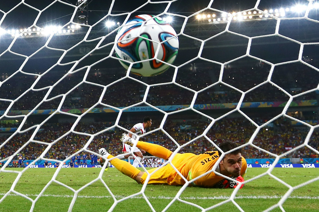 . Michael Umana of Costa Rica shoots and scores his penalty kick past Orestis Karnezis of Greece to defeat Greece in a shootout during the 2014 FIFA World Cup Brazil Round of 16 match between Costa Rica and Greece at Arena Pernambuco on June 29, 2014 in Recife, Brazil.  (Photo by Quinn Rooney/Getty Images)