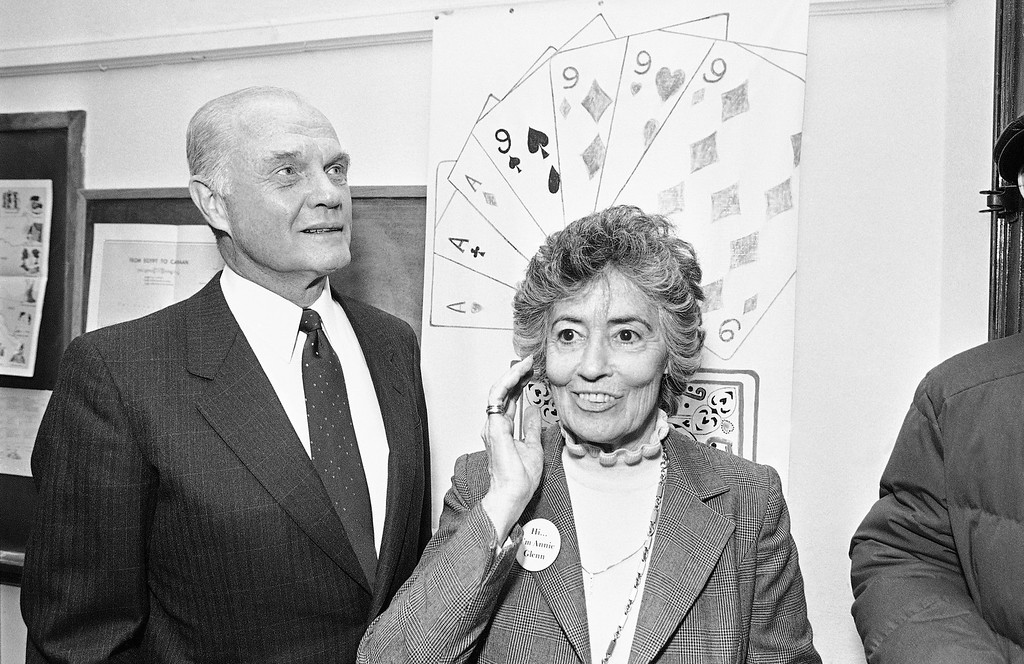 ". Sen. John Glenn, D-Ohio, left, and his wife, Annie Glenn, talk with reporters during Tuesday\'s campaign stop at the St. Patrick\'s senior center, Nov. 30, 1983, Detroit, Mich. Glenn told reporters He was ""green with jealousy\"" as he watched on Monday\'s launch of the Space Shuttle, while snowbound in a Denver motel. (AP Photo/Richard Sheinwald)"
