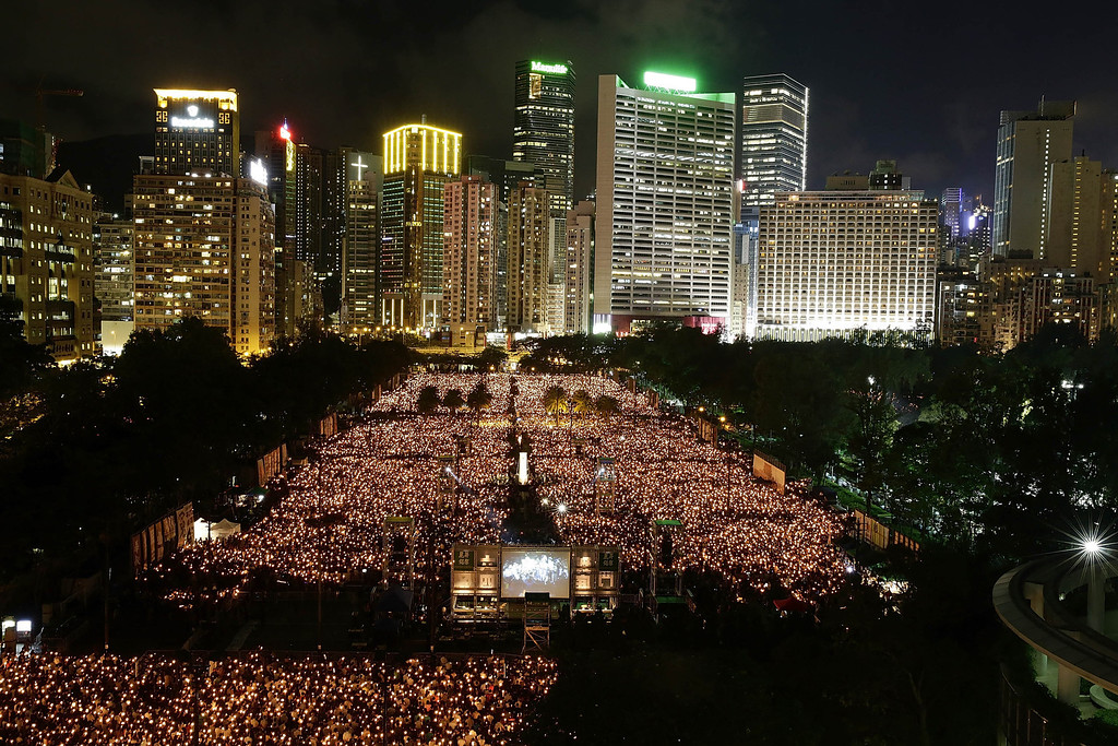 . Thousands of people crowd Victoria Park to mark the 25th anniversary of Tiananmen Square protests with a candle light vigil on June 4, 2014 in Hong Kong. In 1989 on June 4 students led a pro-democracy demonstration in Tiananmen Square, Beijing. The Chinese government brutally responded to stop it hurting and killing thousands of people. (Photo by Jessica Hromas/Getty Images)
