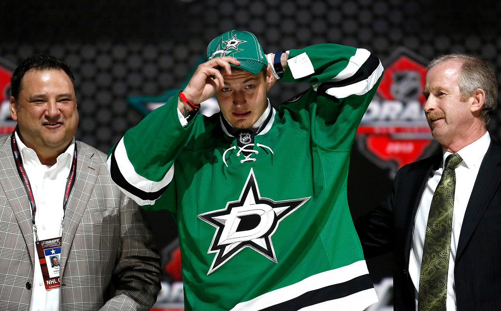 . Valeri Nichushkin of Russia tries on a Dallas Stars jersey and cap after being selected by the Stars as the tenth overall pick in the 2013 National Hockey league (NHL) draft in Newark, New Jersey, June 30, 2013. REUTERS/Brendan McDermid