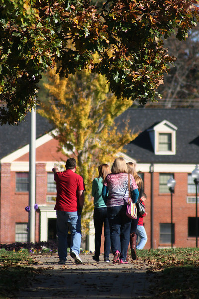 A group of people touring Gardner-Webb University campus on a Fall day.