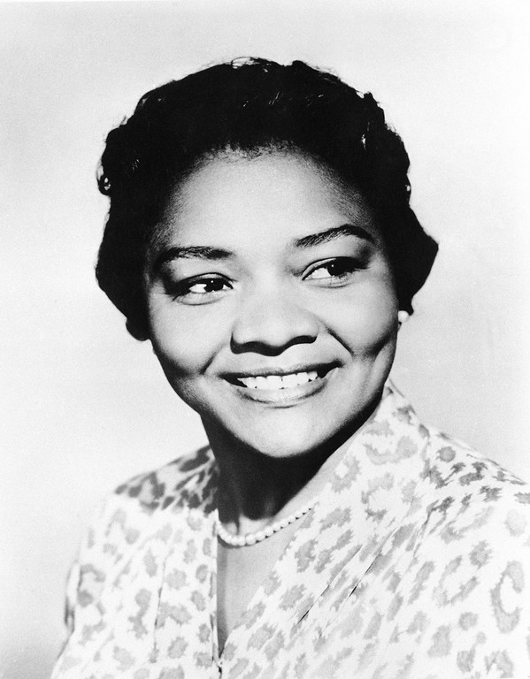 ". This March 31, 1960 file photo shows Juanita Moore, a groundbreaking actress and an Academy Award nominee for her role as Lana Turner\'s black friend in the classic weeper ""Imitation of Life.\"" Actor Kirk Kelleykahn, her grandson, said that Moore collapsed and died Wednesday, Jan. 1, 2014, at her home in Los Angeles.  She was 99, according to Kelleykahn. Accounts of her age have differed over the years.  http://bit.ly/1tcDHHN  (AP Photo, file)"