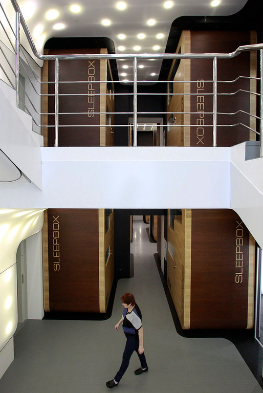 . An employee walks past individual sleeping quarters in Moscow\'s first micro hostel February 3, 2013. The hostel offers accommodation for over 100 people in self-contained prefabricated sleeping cells called sleepboxes, according to the hostel administration. REUTERS/Sergei Karpukhin