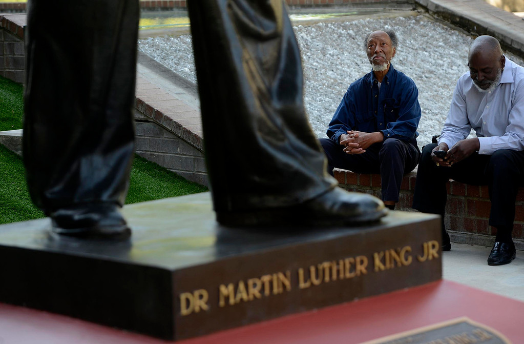 . John Coleman, of Redlands, admires the newly restored Martin Luther King, Jr. statue in downtown San Bernardino April 12, 2013.  GABRIEL LUIS ACOSTA/STAFF PHOTOGRAPHER.