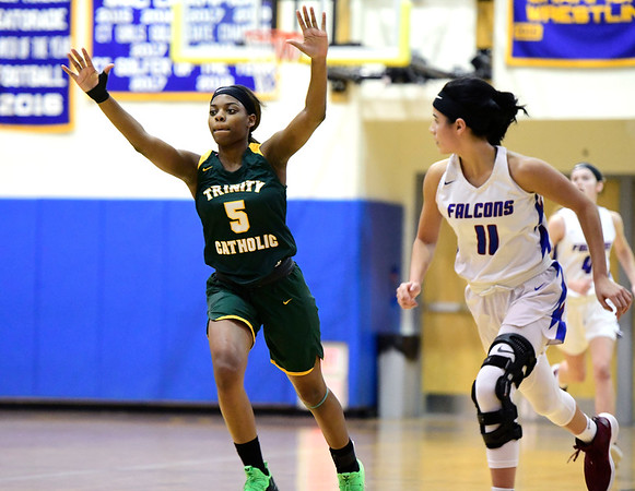 3/8/2019 Mike Orazzi | Staff Trinity Catholic's IKyah Nowlin (5) during the Class S Semifinal girls basketball game at Newtown High School Friday night in Newtown.
