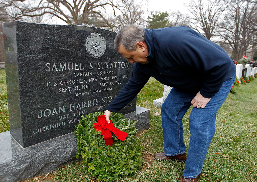 . Maine Gov. Paul LePage lays a holiday wreath over the graves of fallen soldiers at Arlington National Cemetery in Arlington, Va., on Saturday, Dec. 15, 2012, during Wreaths Across America Day. Wreaths Across America was started in 1992 at Arlington National Cemetery by Maine businessman Morrill Worcester and has expanded to hundreds of veterans\' cemeteries and other locations in all 50 states and beyond. (AP Photo/Jose Luis Magana)