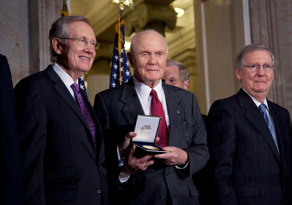 ". FILE - In this photo taken Nov. 16, 2011, astronaut and former Ohio Sen. John Glenn, center, poses with Senate Majority Leader Harry Reid of Nev., left, and Senate Minority Leader Mitch McConnell of Ky., on Capitol Hill in Washington, during a ceremony where Glenn received a Congressional Gold Medal. Glenn says he believes an ""unattractive\"" elections process discourages the best people from pursuing public service. The 90-year-old Democrat is optimistic that good people will run for office but understands some might shy from opening their lives to intense public scrutiny, he told The Columbus Dispatch in a wide-ranging interview published Sunday, Jan. 8, 2012. (AP Photo/Evan Vucci, File)"