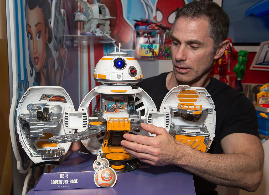 . IMAGE DISTRIBUTED FOR HASBRO - A demonstrator in the Hasbro showroom during the American International Toy Fair plays with the STAR WARS GALACTIC HEROES BB8 Adventure Base from the PLAYSKOOL brand on Saturday, Feb. 18, 2017 in New York. Based on scenes from the STAR WARS: THE FORCE AWAKENS movie and other episodes, the STAR WARS GALACTIC HEROES collection of figures and playsets is sized right for small hands and will bring a galaxy far, far away to Little Jedi! (Photo by Charles Sykes/Invision for Hasbro/AP Images)