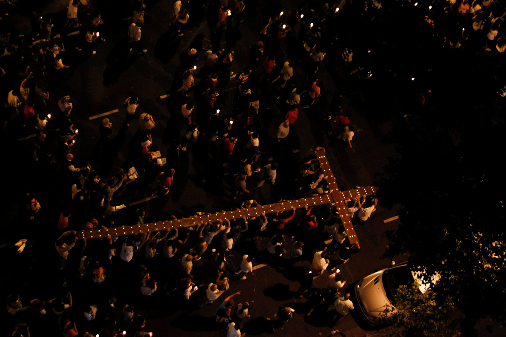 . Roman Catholic faithful carry a cross during the Via Crucis (Way of the Cross) procession during Holy Friday in Buenos Aires March 29, 2013. Holy Week is celebrated in many Christian traditions during the week before Easter. REUTERS/Marcos Brindicci