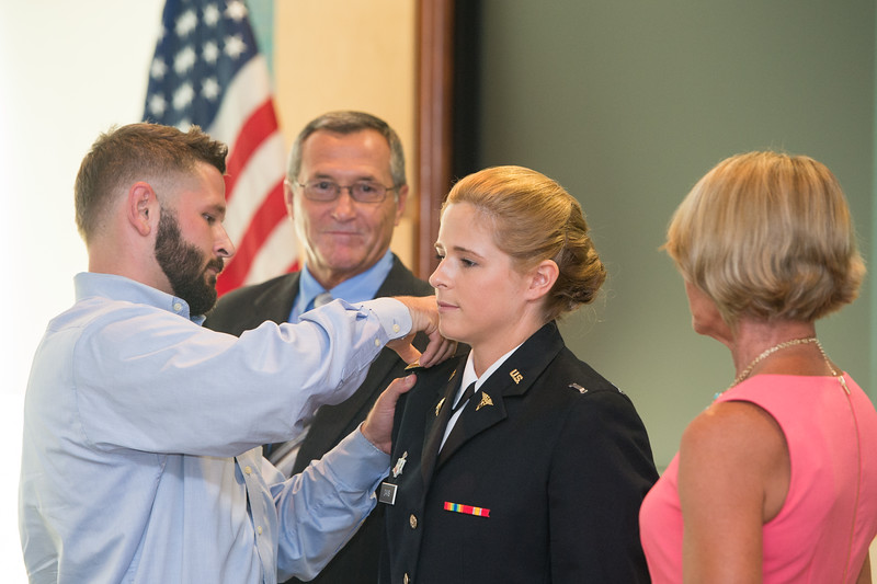 Elizabeth Davis(center) is assisted by her brother, during the commissioning ceremony held on Friday August 07, 2015.