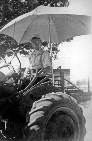 Walter J Duke on Tractor
