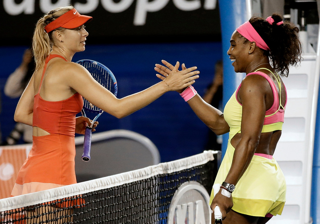 . Serena Williams of the U.S., right,  is congratulated by Maria Sharapova of Russia after winning the women\'s singles final at the Australian Open tennis championship in Melbourne, Australia, Saturday, Jan. 31, 2015. (AP Photo/Bernat Armangue)